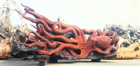 artist transforms  fallen redwood tree   gigantic