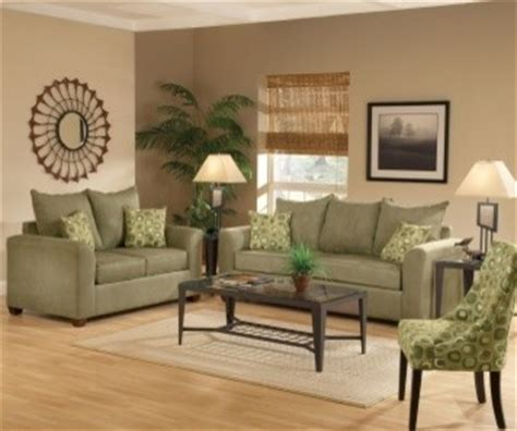 olive green couches and brown floors