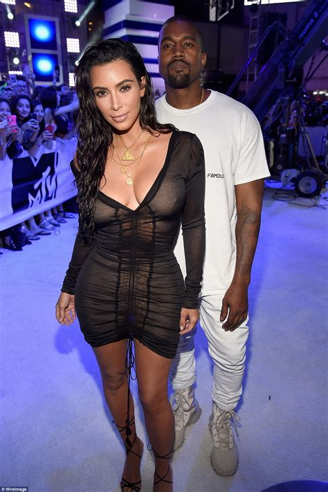 Shows New Do At The Awards by Kanye West Watches Show Figure At