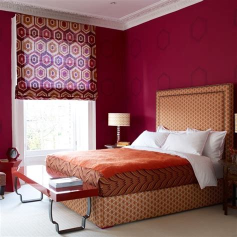 deep red bedroom romantic bedroom with deep red walls and orange upholstery