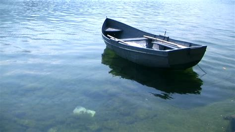 boat floating in water stock video clip of small fishing boat floating on the