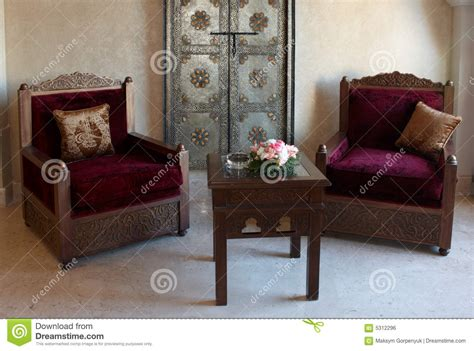old fashioned armchairs old fashioned armchair and table with flowers royalty free