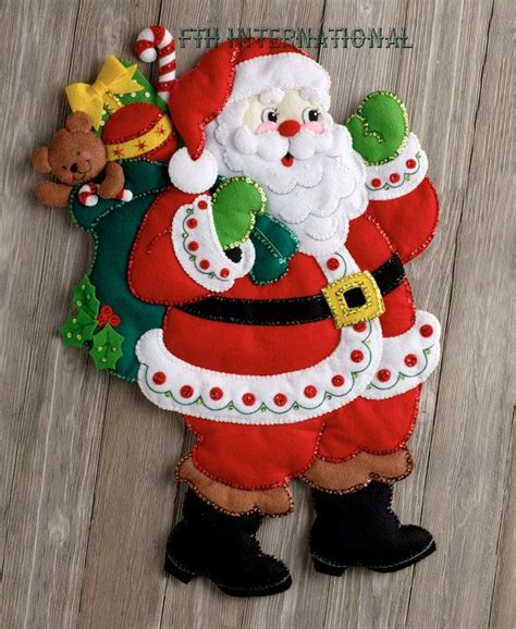 holiday decor manufacturers bucilla here comes santa felt christmas wall hanging