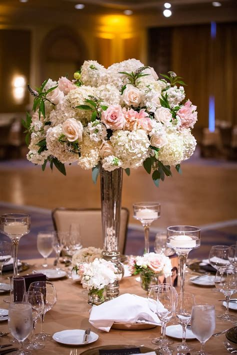 peach, ivory, green floral centerpieces, ballroom wedding