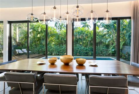 kadur chandelier over dining room table custom blown table pendant lighting makes a timeless statement in