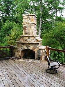 stacked corner fireplace on wooden deck