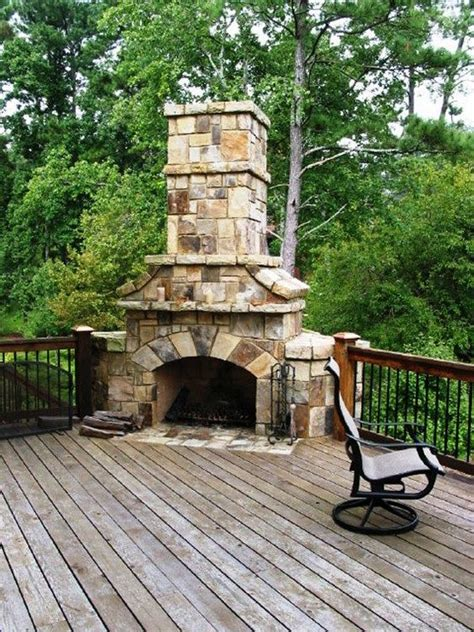 stacked stone fireplace for the home pinterest stone stacked massive corner fireplace on wooden deck