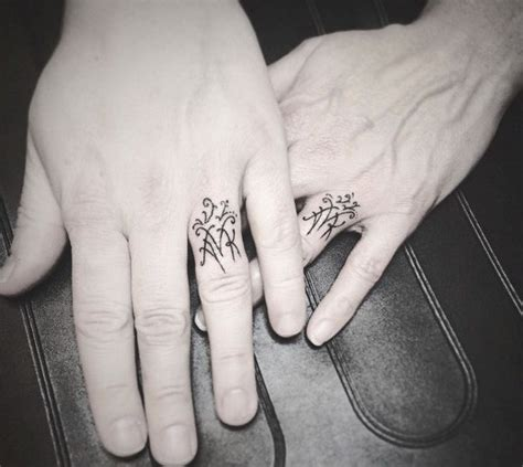 couples ring tattoos 40 sweet meaningful wedding ring tattoos