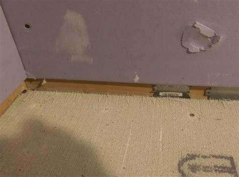 1 Drywall Floor Gap - gap between purple board wall and cement board durock