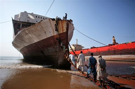 shipping to pakistan workers climbing onto a ship at the gaddani ship breaking
