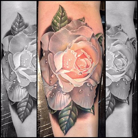 red and white rose tattoo white flower on arm