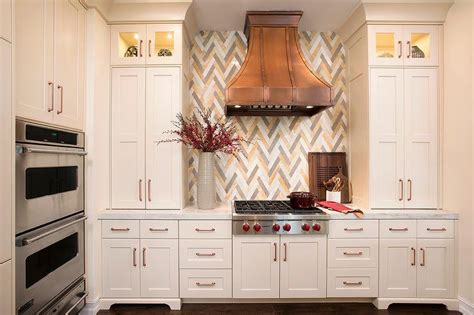 miami shaker cabinets white kitchen transitional with copper accents trim and border tiles kitchen with marble chevron backsplash transitional