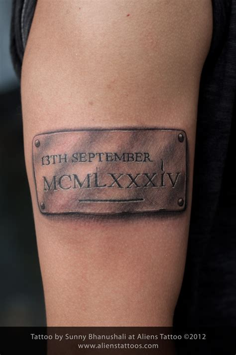 tattoo ideas for date of birth metal badge with dob tattoo inked by sunny at aliens