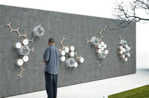 designboom design for death quot family tree quot design integrates sms technology with urns