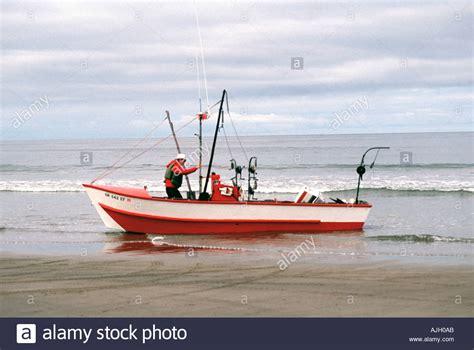 dory boat cape kiwanda adult male prepares his dory boat for a fishing trip cape