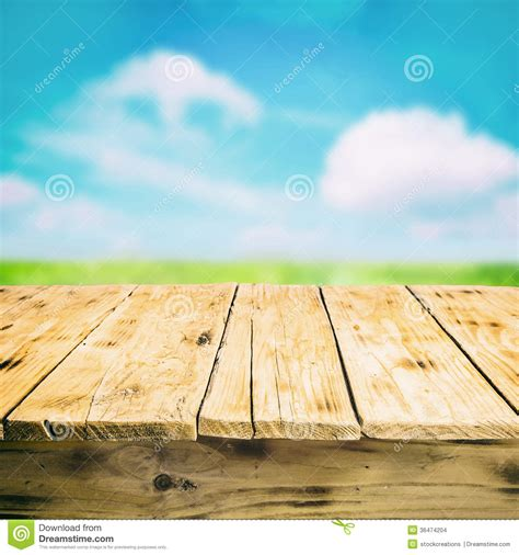 empty wooden table outdoors   countryside stock