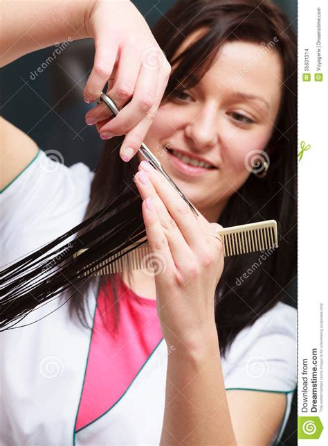 hairstylist cutting hair client in hairdressing