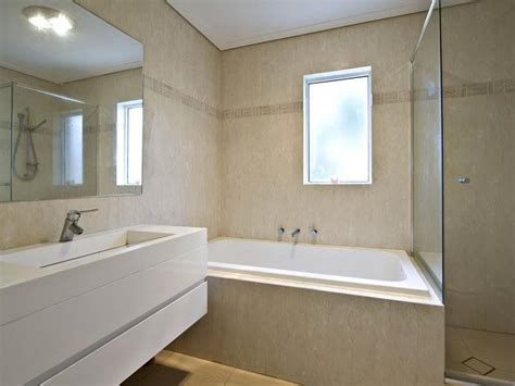 using marble in bathrooms photo of a modern bathroom design with corner bath using