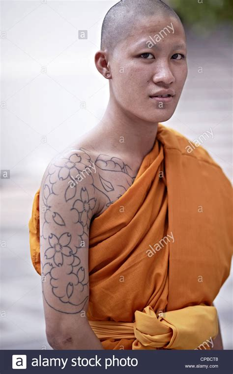 tattooed monk buddhist monk with arm thailand asia stock photo