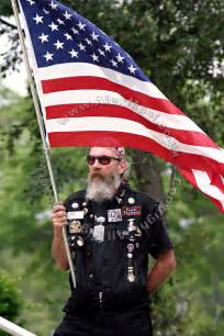 member of the patriot guard riders holding a us flag