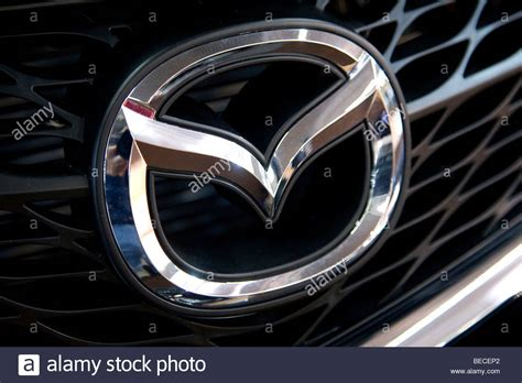 mazda emblem mazda emblem on a car stock photo royalty free image