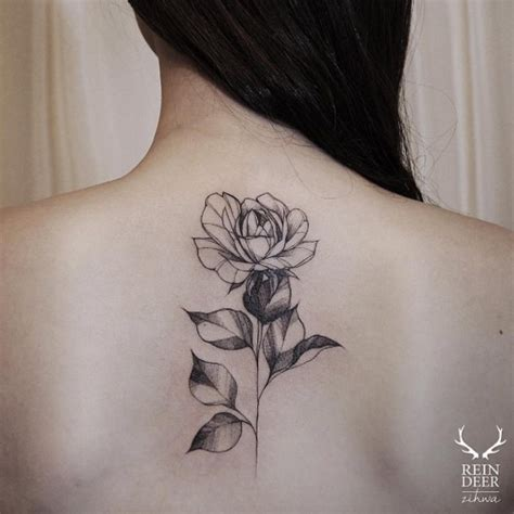 simple black rose tattoo simple designed black ink painted by zihwa back of