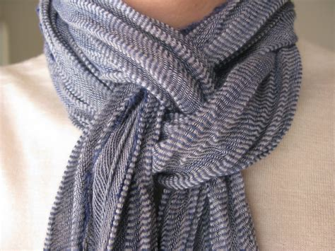 how to drape a scarf around your neck the scarf tie it wrap it twist it up style beauty