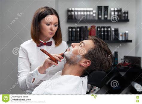 woman shave barber shop woman shaves beard razor stock photo image 74140883
