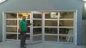Home aluminum amp clear glass garage door with a passing door