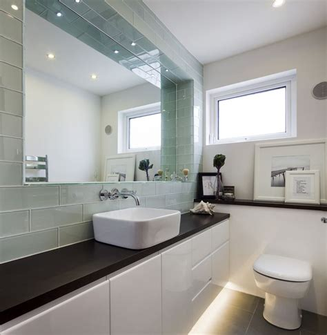 large bathroom design ideas glass rectangular tiles frame a large recessed mirror