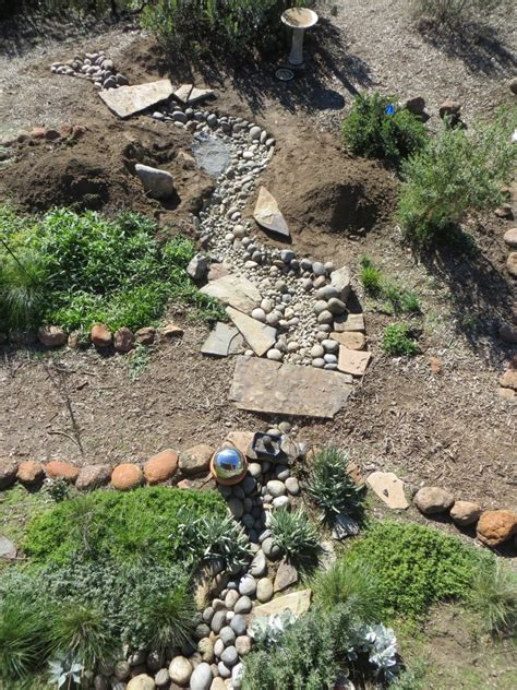 Small Stone Patio Designs Creating A Dry Creek Bed With Tips For A Natural Look