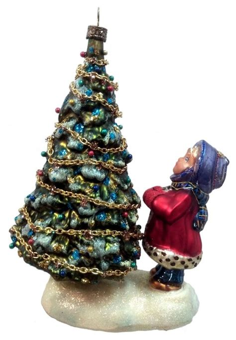 girl looking up at christmas tree polish mouth blown glass