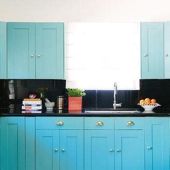 Turquoise Blue Kitchen Cabinets with Glossy Black Floors