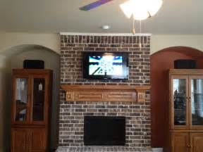 mounting a tv a fireplace neiltortorella