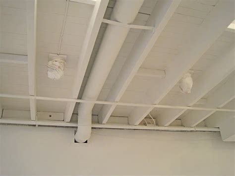 spray painting new drywall painted basement ceiling white basement