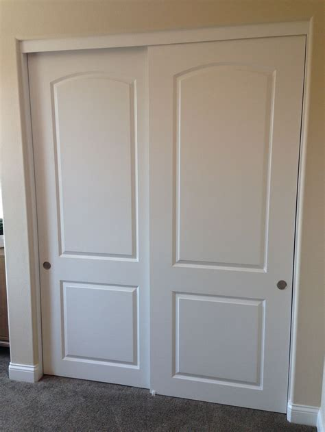 Sliding Bypass Closet Doors 17 Best Images About 2 Panel 2 Track Molded Panel Sliding Closet Doors On Pinterest Wheels
