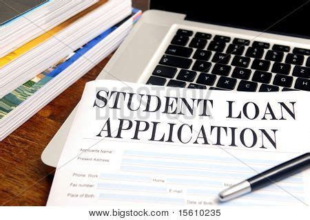 my student loans books blank student loan application on desktop with books and