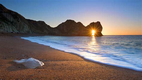 poringueras en las playas playas al atardecer fotos de playas al atardecer imagenes