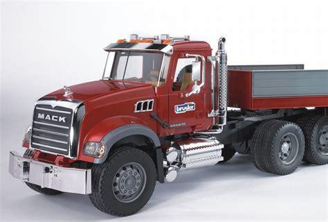 bruder truck nz trucking bruder mack granite low loader with jcb