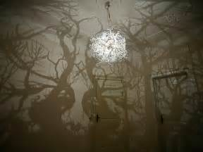 like a chandelier a chandelier that projects tree shadows colossal