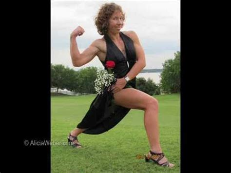 Natural Female Athlete flexing her Big Muscles in a Dress