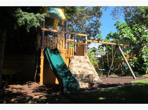 wooden swing sets with rock climbing wall wooden play set with swings slide and rock climbing wall