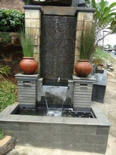 desain air mancur depan rumah model kolam ikan dengan air mancur unik kolam ikan