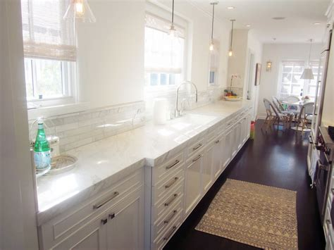 white kitchen cabinets with marble countertops cococozy cococozy exclusive a chic galley kitchen