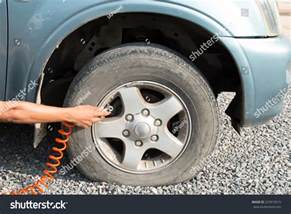Filling Car Tires With Air Filling The Air On Tire Stock Photo 227819515
