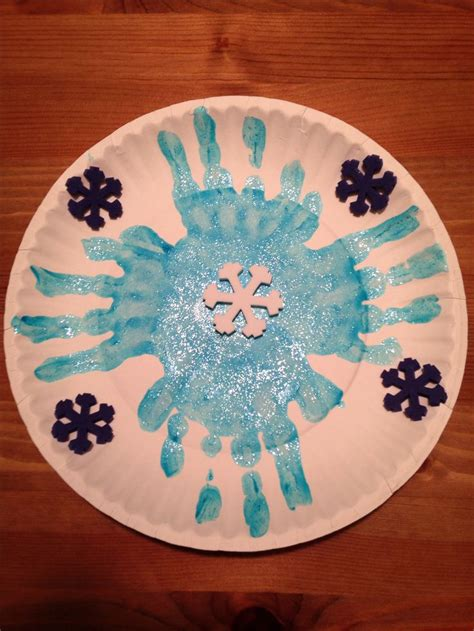 Paper Winter Crafts - paper plate handprint snowflake craft winter craft