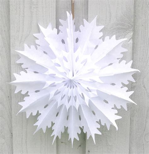 Make Paper Snowflakes For Decorations - chic paper snowflake decorations for this