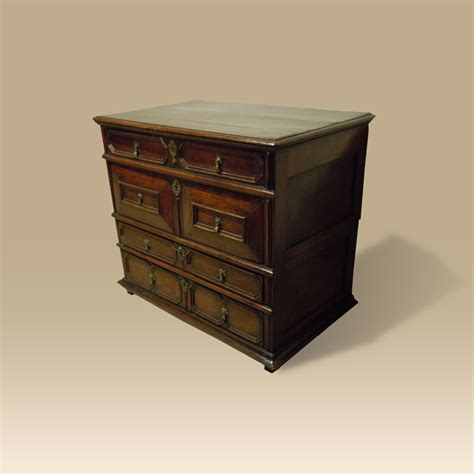 a 17th century oak and walnut chest of drawers