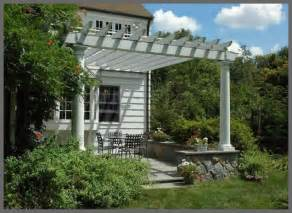 Pergola Kits Attached To House by Attached Pergola With Stone Kneewall