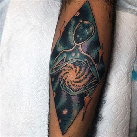 geometric ufo tattoo geometric shaped colored big space alien tattoo on arm